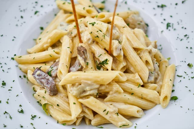 A plate of pasta with sauce and cheese